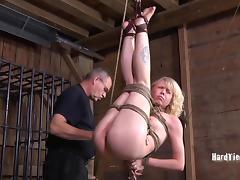 Bondage blonde enjoying nice toy in BDSM seen indoors