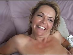 Busty MILF in stockings gets black cock pounding