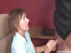 Mature lady sucks a naked guy's cock