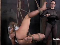 Tattooed bondage dame legs getting spread then spanked in BDSM