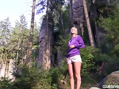 Sweet little blonde called Sara visits the wilderness and masturbates