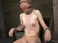 Skinny Emma Haize is tied up and treated in a rough BDSM way