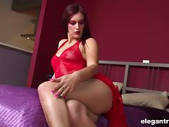 Sexy solo model Mira Sunset pushing the thin red toy into herself