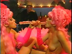 Two ladies with big pink wigs are going lesbian and looking awesome!
