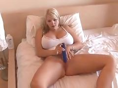 Super hot British chick with massive tits fucks herself