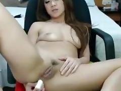 Thai camslut sticks dildo up her butthole
