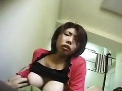 Big breasted Oriental cutie with a phenomenal ass sucks a h