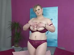 Big breasted housewife plays with her wet pussy