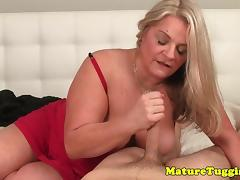 Busty mature sensually rubbing hard cock pov