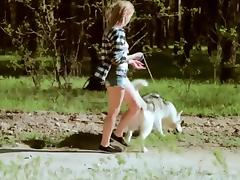 Beautiful college girl takes  a walk with the dog