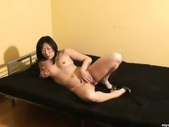 Asian wife wears only heels while toying her trimmed twat