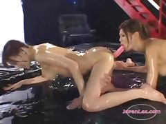 2 Asian Girls Jelly On Bodies Fucking Pussies With Doubledildo On The Wrestling Mat