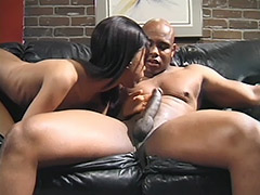 Black Couple is Fucking a Hairy Pussy Quickie on a Black Leather Sofa