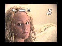 Honey blonde with curly h Honey blonde with curly hair winked in the cam and took care of her busine