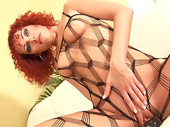 Curly red hair on sultry solo model