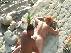 Voyeur Redhead Mature Gets Massaged and Fucked On The Beach