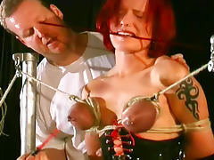 Tits turn blue in bondage porn video
