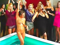 Clothed ladies have hot mud wrestling
