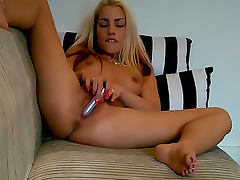 Silver dildo pleasures this pretty pussy