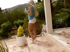 Long haired blonde babe toys her ass in the courtyard