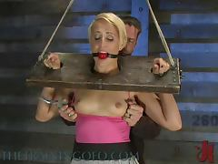 Gag Ball In Her Mouth and a Vibrating Toy In Her Pusy In BDSM