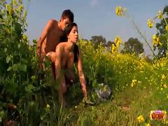 Teens fuck in flowery field