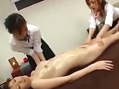 Asian Girl Massaged Getting Her Tits Rubbed Pussy Fingered By 2 Masseuses On The Massage Bed