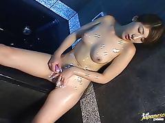 Foamed Japanese siren rubs her wet pussy