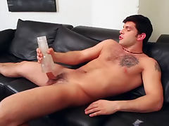 Burly solo guy uses sex toy on cock