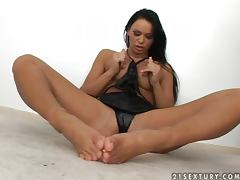 Christina Bella enjoys licking and sucking her beautiful toes