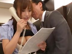 Kokone Mzutani sucks some dude's cock in the office
