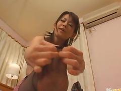 Ai Himeno gives an awkward footjob to her horny man