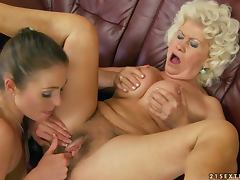 mature blonde seduces a pretty chick and makes her lick her pussy