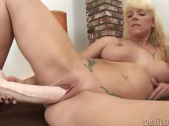 Heidi Mayne slams her snatch with a big realistic dildo