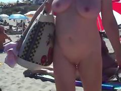 Spy cam catches a woman sucking a dick on a nude beach
