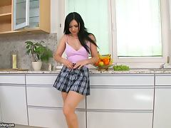 Angell Summers fucks her pussy with a banana in the kitchen
