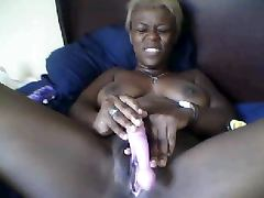 Hot black woman using dildo