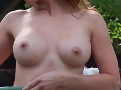 Alexandra Johnson the hot redhead babe takes a bath in the backyard