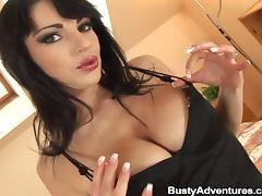 Passionate brunette slut in fishnets gets fucked on a bed