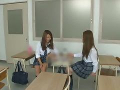 Two hot Japanese teens in school uniform in hot threesome video