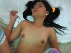 Nasty pigtailed Thai babe being drilled so hard in her pussy
