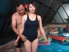 Asian sex doll in plastic pool gets tits and cunt teased