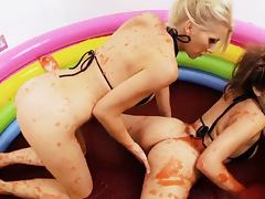 British slut Sammy in a lesbian scene in the paddling pool