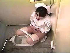 Japanese nurse plays with her pussy in a toilet Hidden cam clip