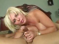 Big breasted mature blonde takes a cock in her mouth before riding it