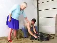 Lewd granny Cecilia gets her cunt and ass fucked in a barn