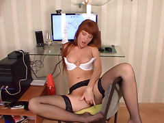 Redhead beauty Polina is penetrating her vagina