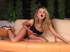Curly blonde Zoe McDonald is taking off he panties