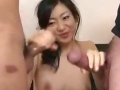 Japanese slut has to play with two dicks in nice threesome clip