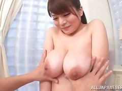 Japanese chick with huge boobs gives great titjob